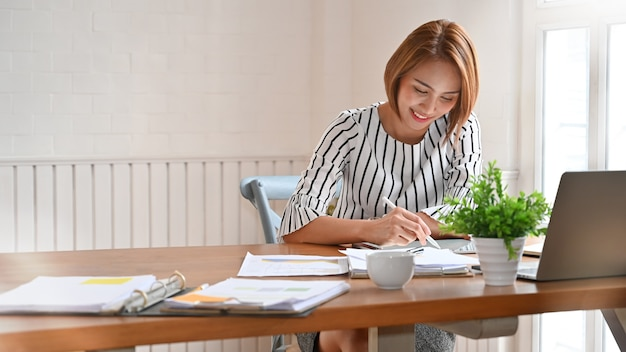 Adult woman working with digital tablet and pen. Premium Photo