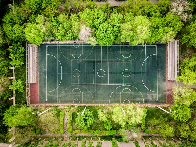 Aerial basketball court top down overhead between the trees in the forest Premium Photo