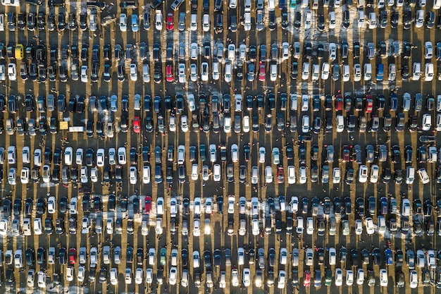 Aerial drone image of many cars parked on parking lot, top view. Premium Photo