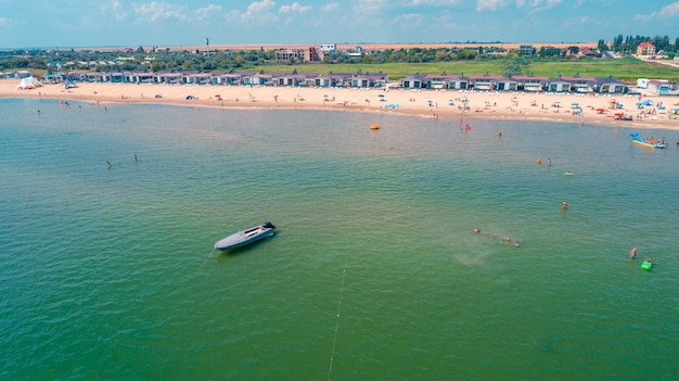 Aerial drone photo of sea bike with couple paddling Premium Photo