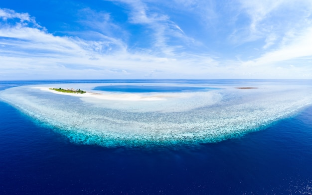 Aerial idyllic atoll, blue lagoon and turquoise coral reef Premium Photo