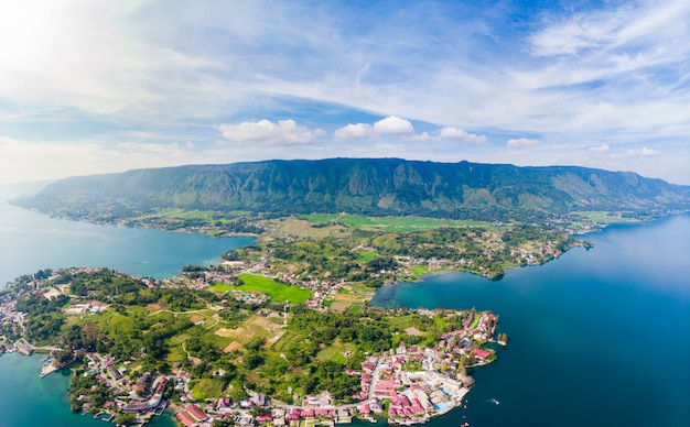 Aerial: lake toba and samosir island view from above sumatra indonesia. Premium Photo