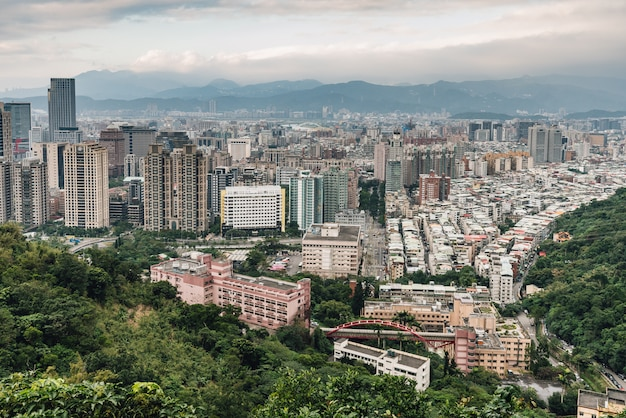 Aerial panorama over downtown taipei with layers of mountain in background Premium Photo