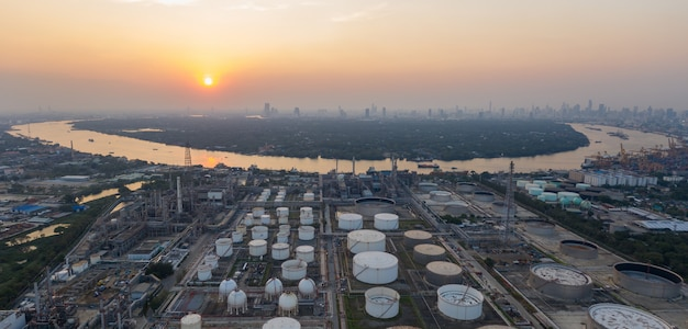 Aerial panorama view over oil refinery and river at twilight time. Premium Photo