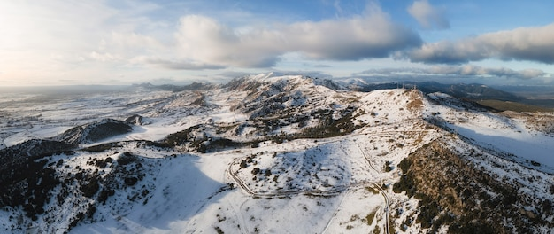 Aerial panoramic view of snow covered high mountains. Premium Photo