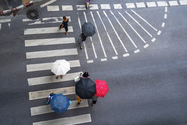 Aerial photo top view of people walk on street in the city over pedestrian crossing traffic road Premium Photo