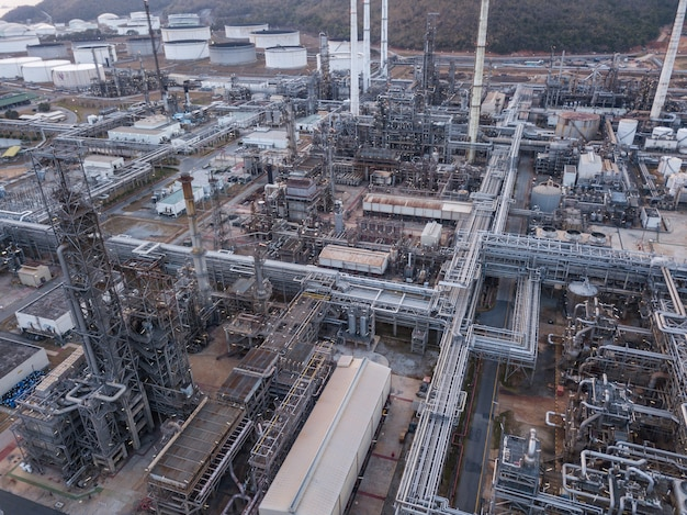 Aerial photographs of oil refineries plants, gas tank, oil tank, chemical tank, refinery industry power investment business concept. Premium Photo