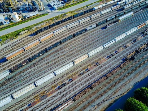 Aerial shot of railroad tracks and cars Free Photo