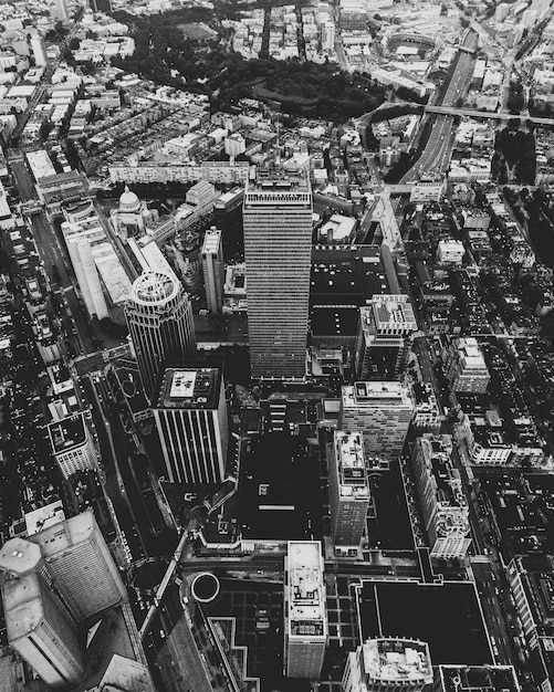 Aerial shot of an urban city in black and white Free Photo