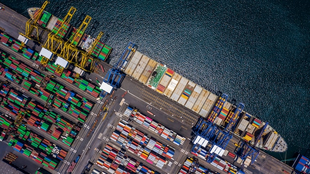 Aerial top view container cargo ship unloading in import export business Premium Photo