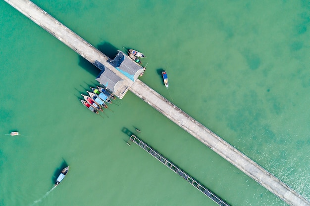 Aerial top view drone shot of bridge with long tail boats fisherman in summer season Premium Photo