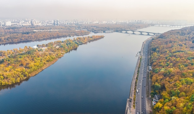Aerial top view of kyiv autumn cityscape and parks, dnieper river, truchaniv island and bridges from above, kiev city skyline, ukraine Premium Photo