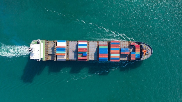Aerial top view of large container cargo ship in export and import business and logistics at sea Premium Photo