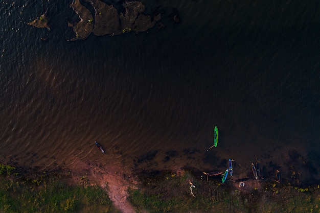 Aerial top view river and boat fisherman background. Premium Photo