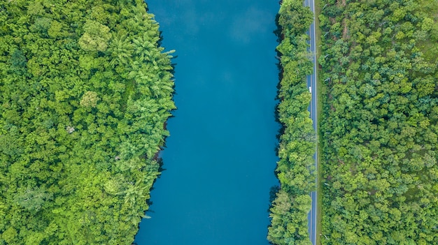 Aerial top view road track with car and river | Premium Photo