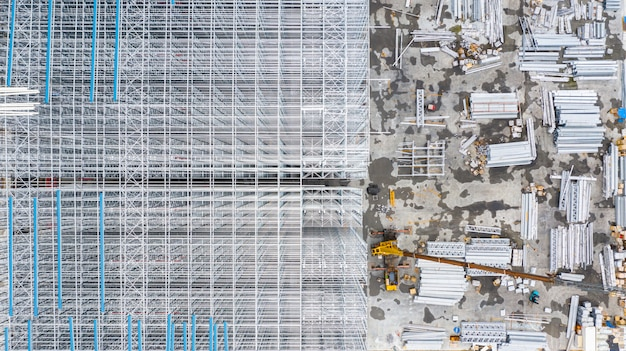 Aerial top view structure of steel building construction, metal steel frame buildings construction design, aerial view construction site. Premium Photo
