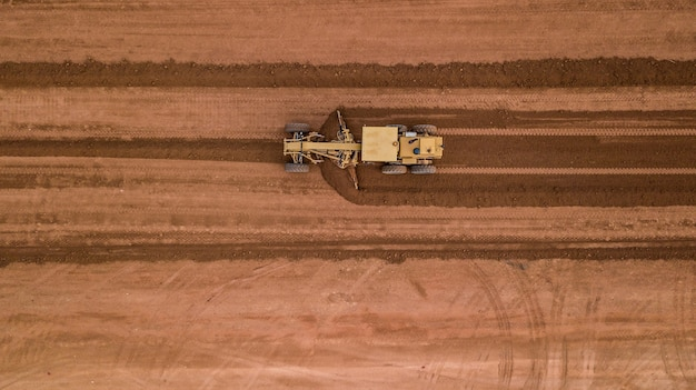 Aerial top view tractor at work Photo | Premium Download