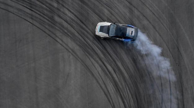 Aerial top view two car battle drifting car Photo | Premium
