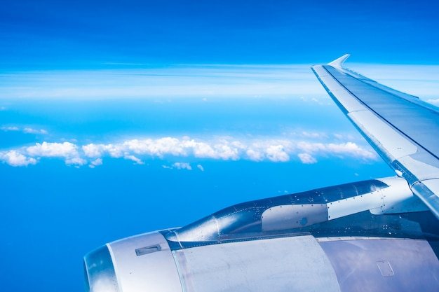 Aerial view of airplane wing with blue sky Free Photo