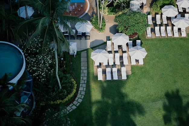 Aerial view of amazing porch with garden umbrella and loungers Free Photo