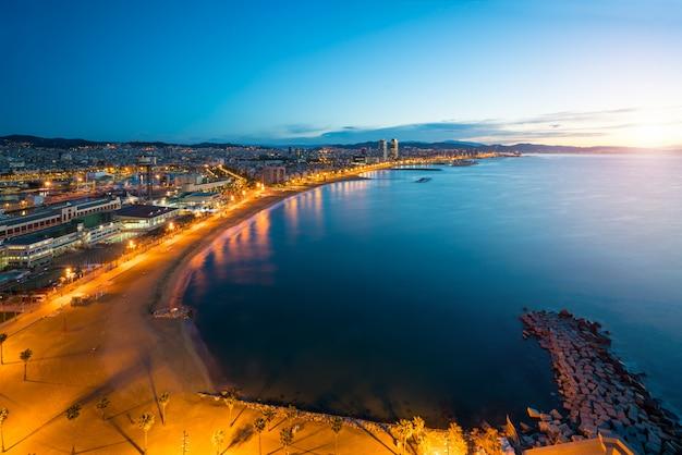 Aerial View Of Barcelona Beach In Summer Night Along Seaside In