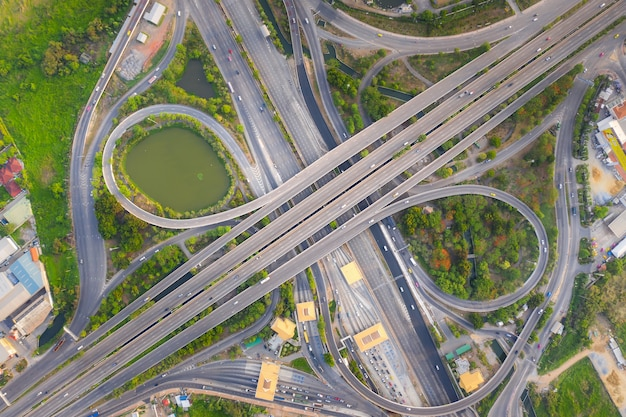 Aerial view above of busy highway road junctions at day. the intersecting freeway road overpass. Premium Photo