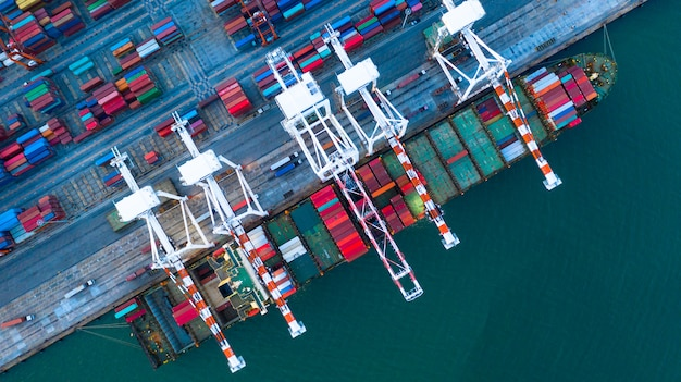 Aerial view of cargo ship and containers Premium Photo