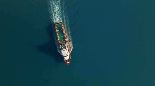 Aerial view of cargo ship for logistics import export, shipping or transportation Premium Photo