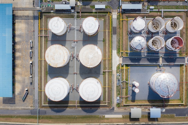Aerial view of chemical industry storage tank and tanker truck in wailting in industrial plant to tranfer oil to gas station. Premium Photo