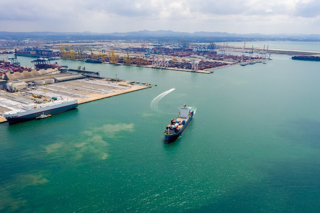 Aerial view container cargo ship in import export business  service commercial trade logistic and transportation international by container cargo ship in the open sea, Premium Photo
