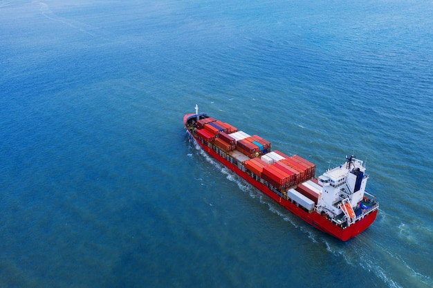 Aerial view of container cargo ship in sea. Free Photo
