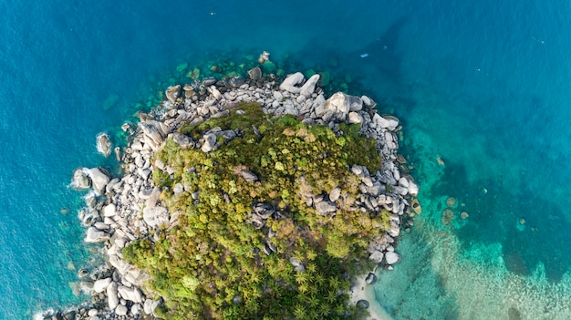 Aerial view of crashing waves on rocks landscape nature view and beautiful tropical sea with sea coast view in summer season Premium Photo