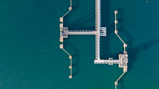 Aerial view crude oil and gas terminal, loading arm oil and gas refinery at commercial port. Premium Photo