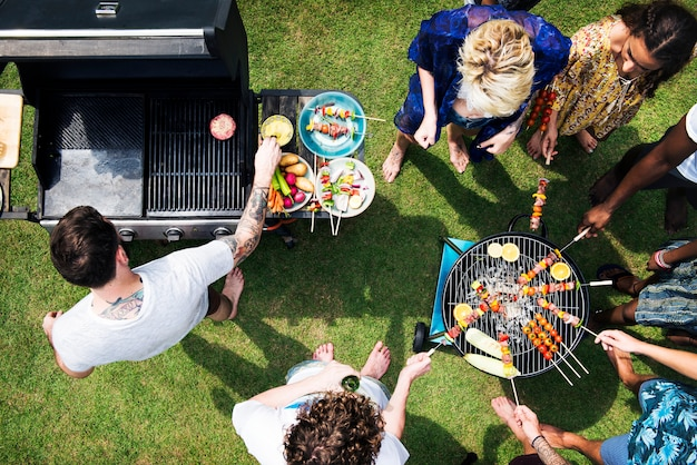 Aerial view of diverse friends grilling barbecue outdoors Premium Photo