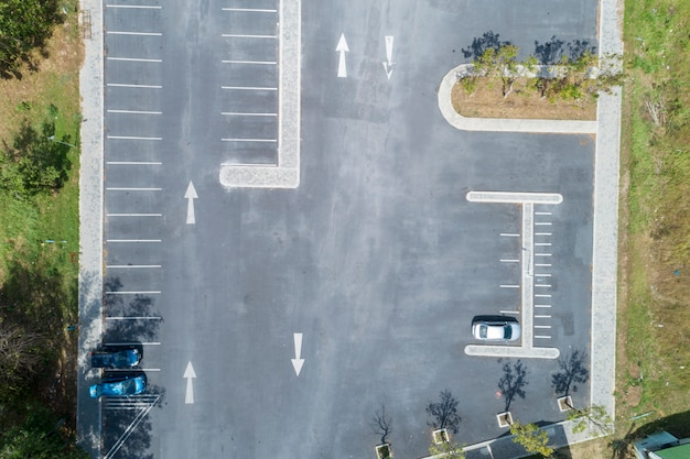 Aerial view drone shot of parking lot outdoors vehicles in the park Premium Photo