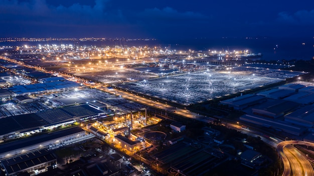 Aerial view factory zone and shipping port on the sea at night Premium Photo