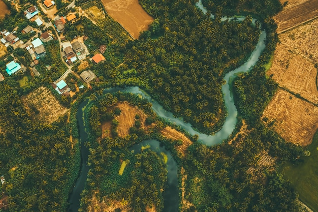 Aerial view from drone of devious river and agriculture area Premium Photo
