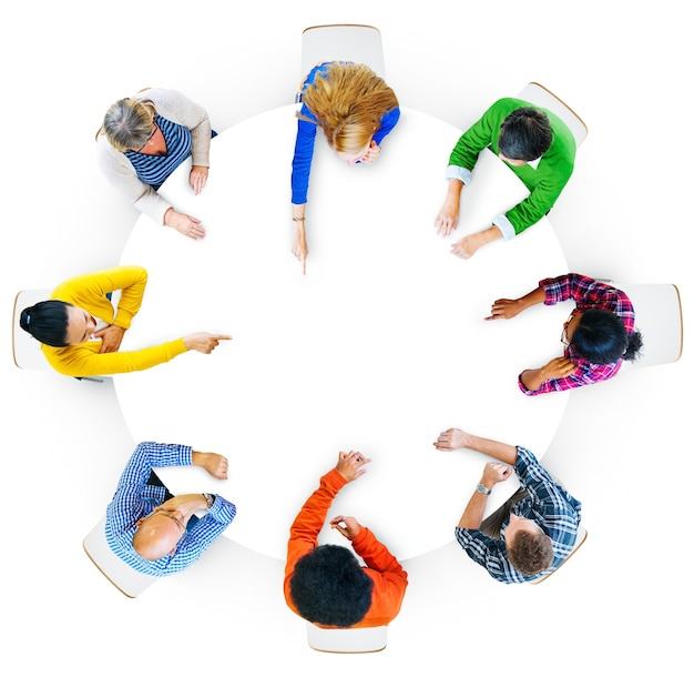 Aerial view of hands pointing in design space area Free Photo