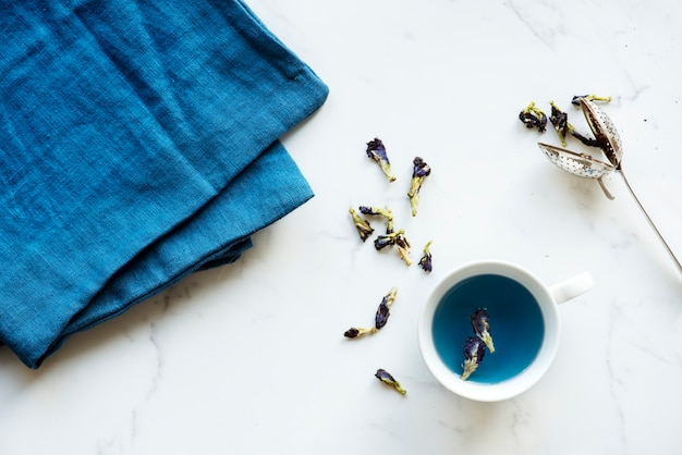 Aerial view of hot butterfly pea tea drink Free Photo