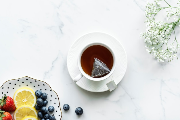 Aerial view of hot tea drink and fruits Free Photo