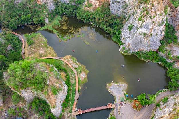 Aerial over view khao ngoo mountain rock or snake mountain rock are high cliff and ratchaburi province thailand Premium Photo