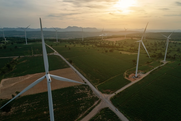 Aerial view of large wind turbines at sunrise taken from the air. wind turbines farm park. Premium Photo