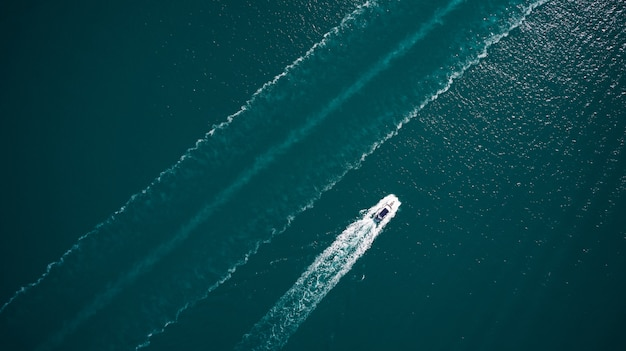 Aerial view of luxury floating boat on blue adriatic sea. Premium Photo