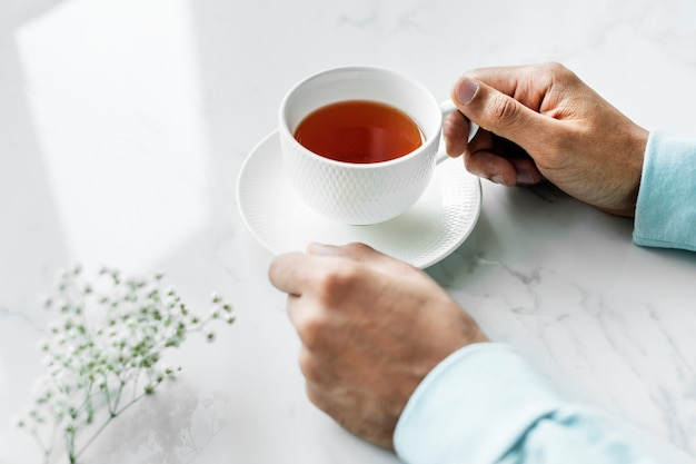 Aerial view of man with a hot cup of tea Free Photo