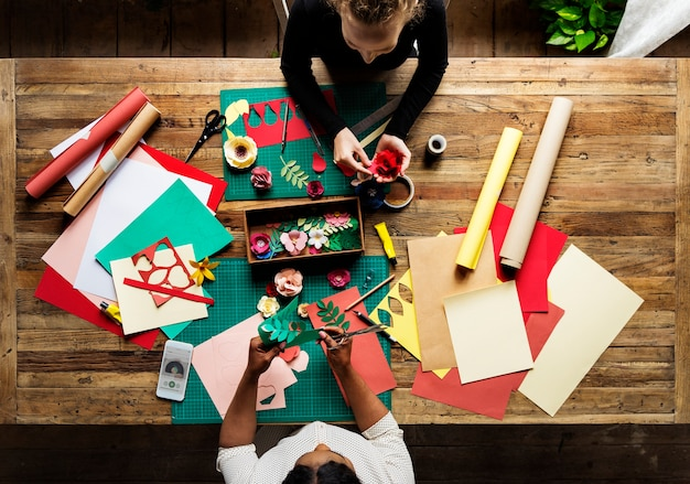 Aerial view of messy paper craft work table Premium Photo