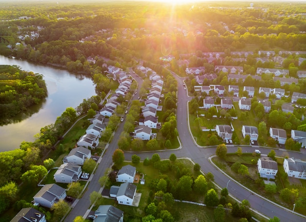 Aerial view of modern roofs of houses early sunrise Premium Photo