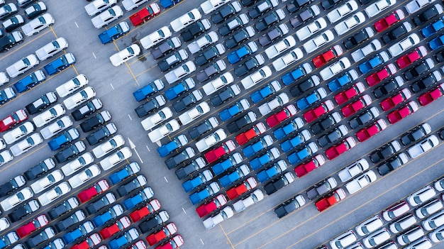 Aerial view new cars for sale stock lot row, new  cars dealer inventory import export business logistic grobal. Premium Photo