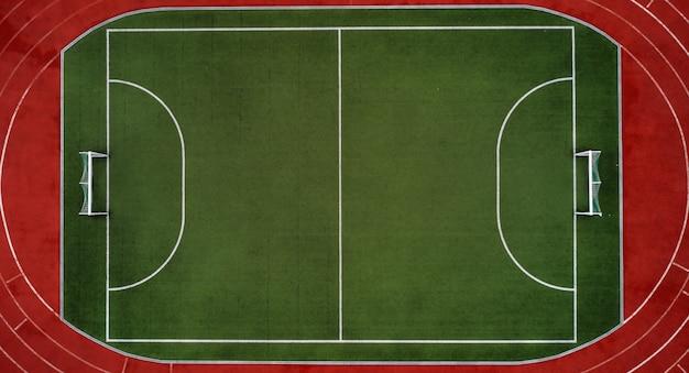 Аэрофотоснимок футбольного поля или спортивного стадиона Premium Фотографии