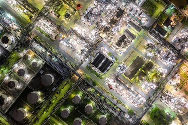 Aerial view oil refinery and gas refinery plant form industry zone at night. Premium Photo