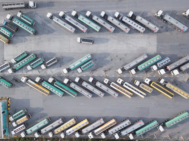 Aerial view of oil trucks are parked in the parking lot waiting to transport the oil. Premium Photo